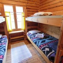Here is a bedroom at one of Lesnoe Ozero's cabins.