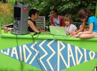 <p>Play the latest global hits on <i>Waldsee's </i>own low frequency radio station! Operate a radio sound studio, broadcast live, spin tunes and offer contests for your adoring listeners—all while learning and speaking German!</p>