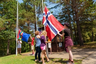 <p>Raising the flags marks the start of the day at <i>Skogfjorden</i>.</p>