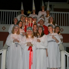 Credit villagers dressed up as Sankta Lucia and her attendants ready to deliver fresh baked lussekatter(Lucia buns) to sleeping villagers and surprise them with songs.