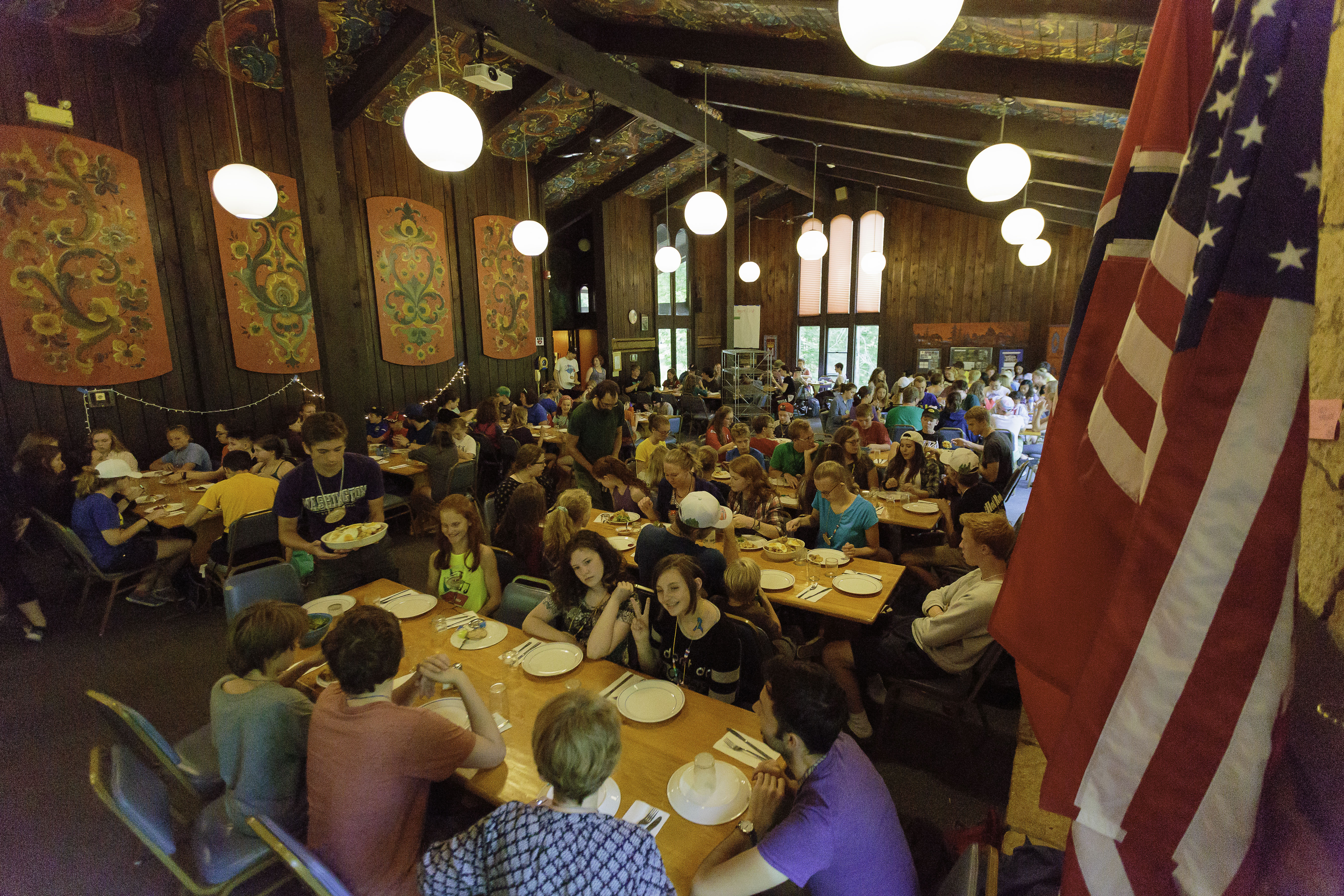 Villagers eating dinner in the Norwegian dining hall