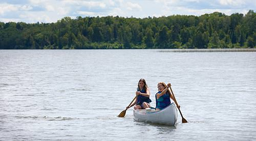 Take advantage of Minnesota summer by swimming at your Village's private beach or canoeing around the lake.