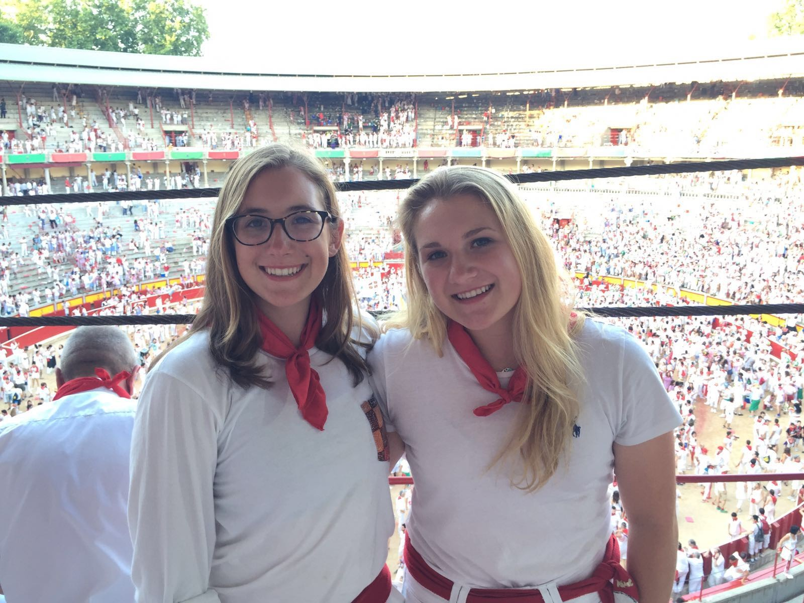 The author's daughters pose at the San Fermin festival in Spain.