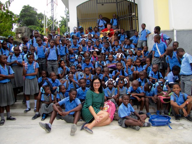 Students of A New Arrival Center Primary School with Sara Lein, Kozefo Director (front) and Steve (back)