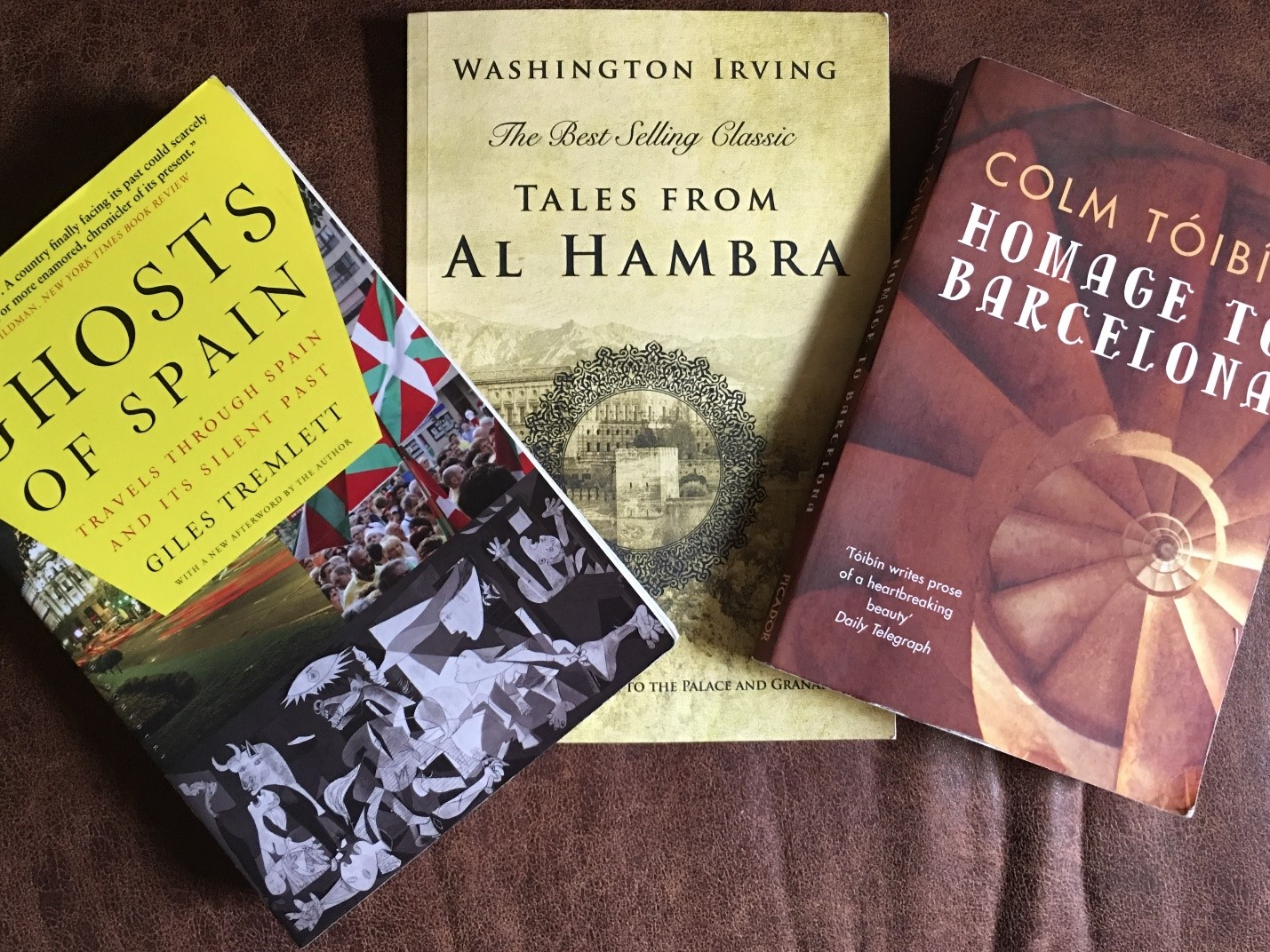 Not your typical Spain travel guides: Washington Irving, Giles Tremlett, and Colm Toibin.